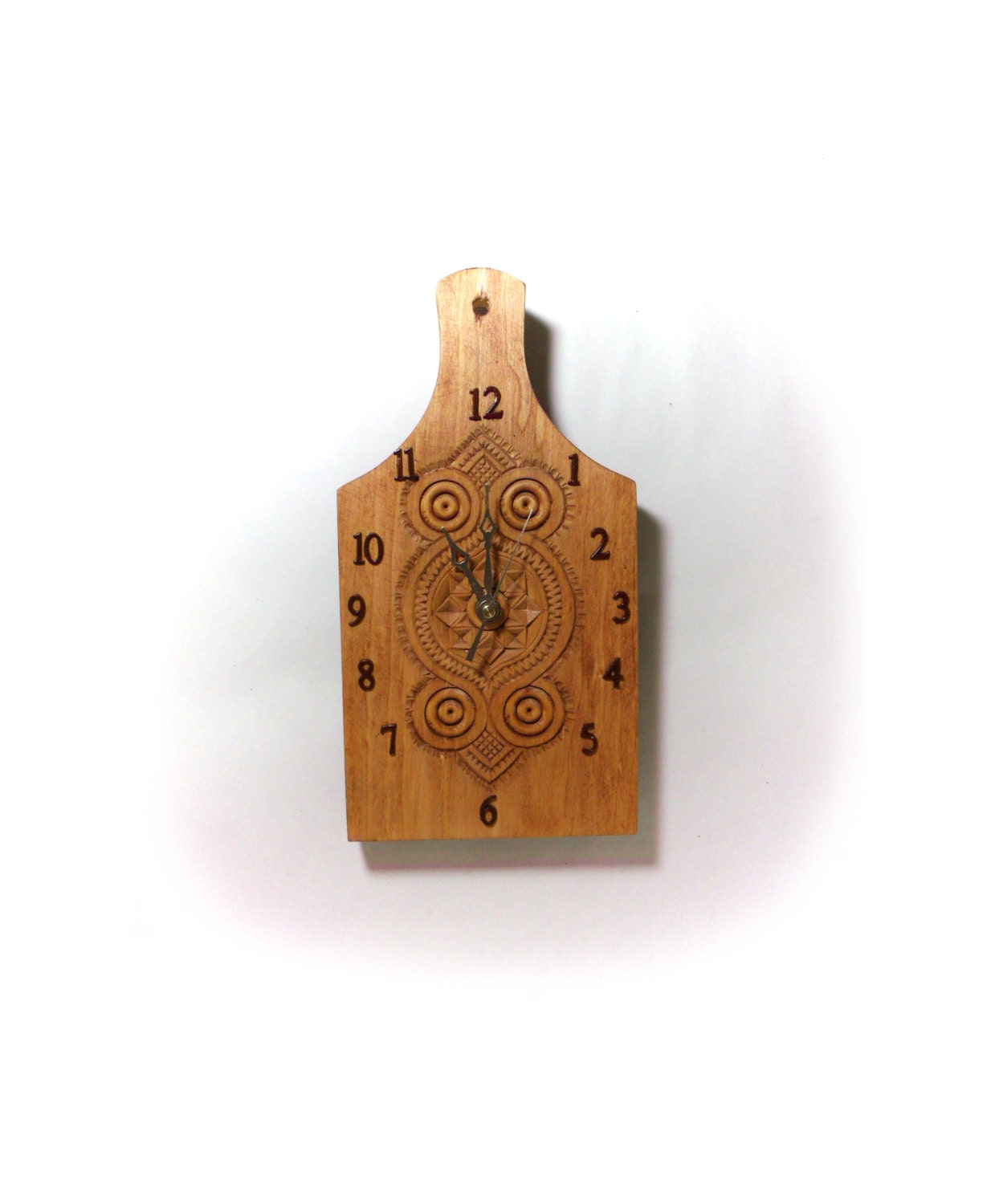 Chip carved wood paddle made into a clock