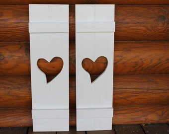 Primitive shutters with a heart shape cutout. Set of 2. Great for primitive decor.