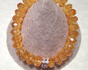 Genuine Citrine stretch bracelet with Gold plated details