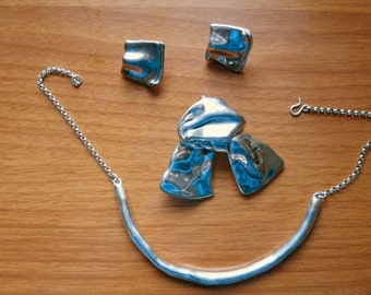 silver necklace, pin and matching earrings