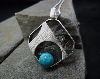 Sterling silver pendant decorated with d a 8mm turquoise bead