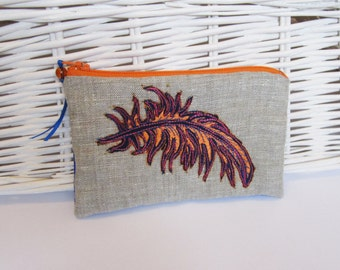 Small zip up embroidered purse with orange feather design