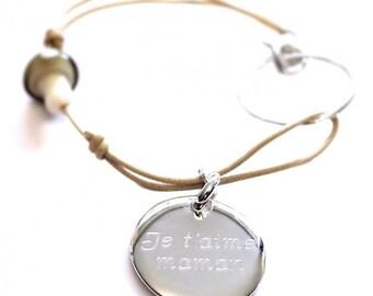 Medal and mushroom of glass bracelet