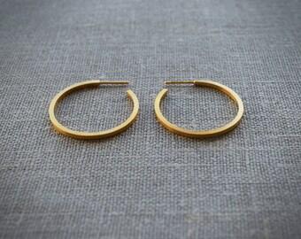 18 k Gold filled hoop earrings. Square thread