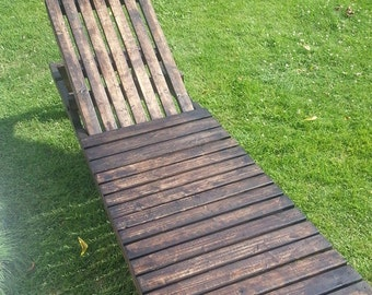 Handmade outdoor wooden chaise lounge.