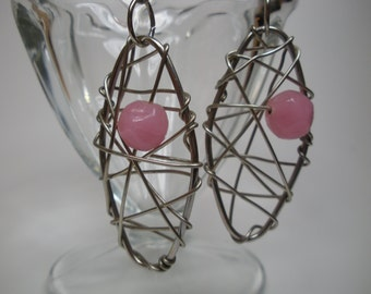 Silver wire wrapped oval earrings with pink beads
