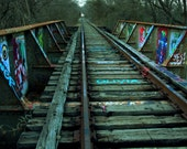 Olivia. Abandoned, graffiti covered rail road bridge. Photographic Print. 4x6, 5x7, 8x8, 8x10, 11x14, 12x12, 16x20.