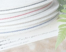 "Decorative fabric ribbon ""Stitching"" (per meter)"