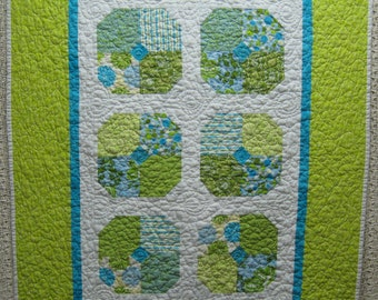 Free shipping in the U.S. for this lovely Contemporary Beach Blossoms Baby Quilt