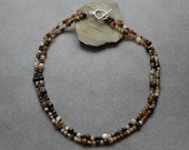 Faceted Agate double strand necklace in white, brown, black and every shade in between with Sterling Silver toggle clasp.
