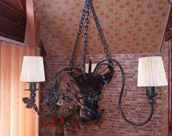 Wrought iron chandelier .Forged sconces,