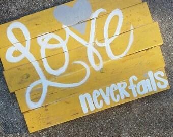 "Distressed Wood ""Love Never Fails"" Wall Art"
