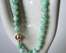 Apple-green jade bead necklace with 14kt oriental clasp