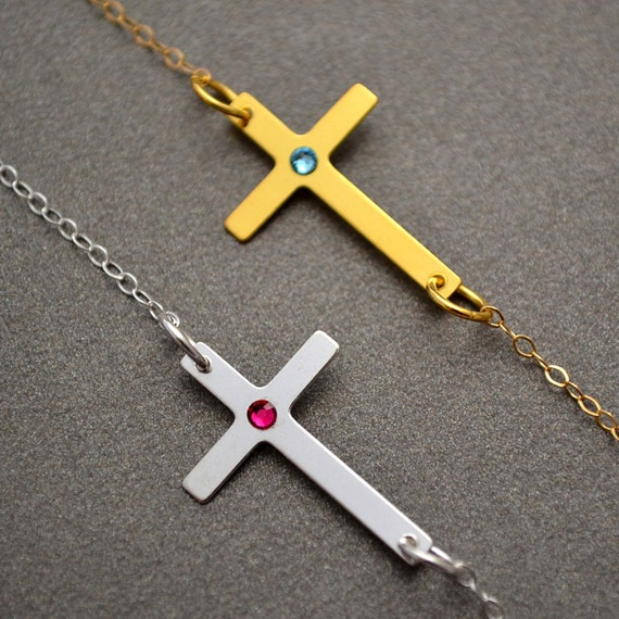 Gold sideways cross necklace with by