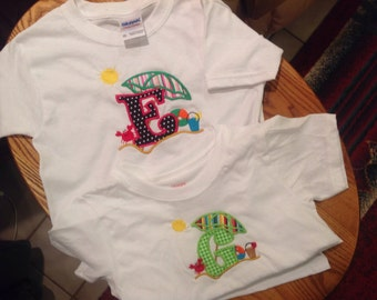 Kids T-shirts with beach theme with appliquéd initial.