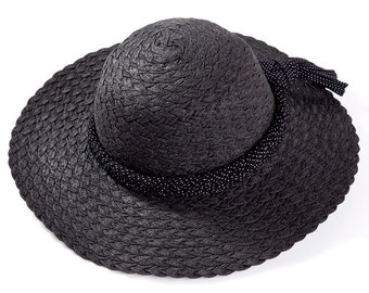 Black hat , Straw hat , Sun hat , decorated with a braided ribbon & a tassel.