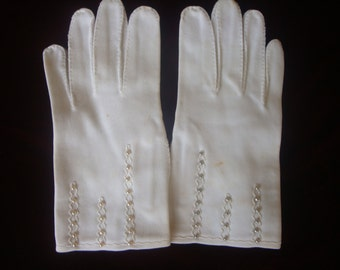 1950's white gloves with beaded detail.