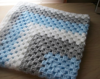 Hand crocheted baby blanket. In blue, pale grey and white. Suitable for car seat, crib, pram or moses basket. Ideal just to wrap baby in.