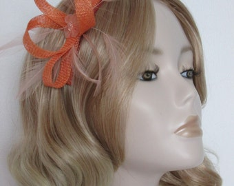 APRICOT and PEACH FASCINATOR, with Peach Stripped hackle Feathers,organza and beaded flower,on a comb