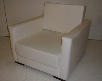 Urban Retro Flip Out Chair Bed Upholstered in A  Premium White Faux Leather