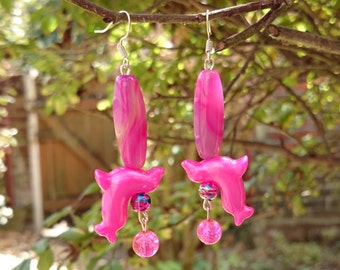 Hot Pink Seals and Agate Earrings - Earrings made with long, fuchsia agate beads, pearly plastic seal shaped beads and glass crackle beads