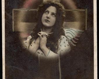 Vintage postcard 1910 beauty LAdy PRays Looking Up Cross & Wings RPPC
