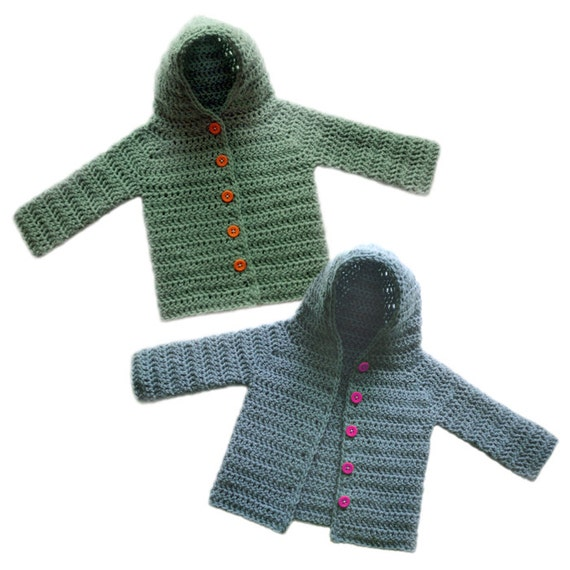 Baby boys blue and ivory Nordic style cardigan from Ralph Lauren. Woven in a soft cotton and wool blend, this classic winter design features reindeer and snowflakes, with front button fastening and a hood.