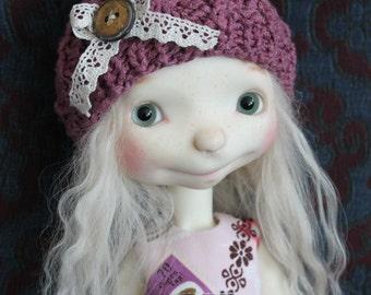 Knitted hat for Marbled Halls Sprocket doll