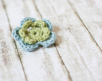 Flower brooch in dusty pastels of blue and green crochet flower brooch decoration