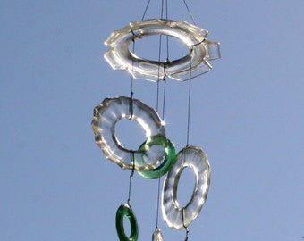 glass wind chime mobile made from clear and green recycled wine and liquor bottles