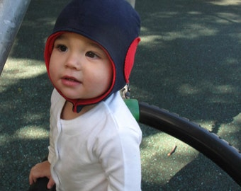 Baby boy aviator hat with snap closure, helmet hat. Warm and soft jersey. Sizes 0-24 mo. Made in Italy.