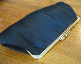 Vintage black handbag or clutch.  Ladies clothing.  Accessory.