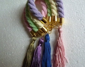 Bangle bracelets made of twisted wide COTTON ROPES and long silk TASSELS. pastel colors. tassel bracelet. high fashion. avant garde.cuff