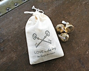 Wedding favor bags, set of 50 drawstring cotton bags. Skeleton keys with Love is the Key to Happiness text. Bridal shower favor bags.