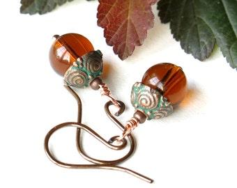 Brown dangle earrings - whiskey glass bead & verdigris copper