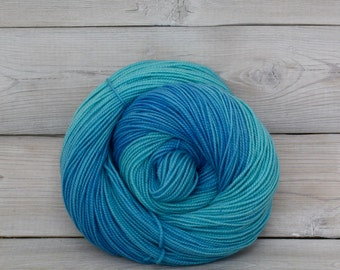 Celeste - Hand Dyed Superwash Merino Fingering Sock Yarn - Colorway: Boca Chica