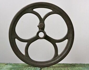 Salvaged metal pulley wheel