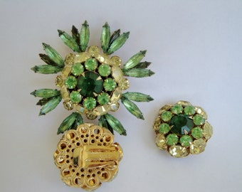 Vintage Judy Lee brooch and clip earrings rhinestone green glass demi parure set in gold metal Astronaut Wives Mad Men prop