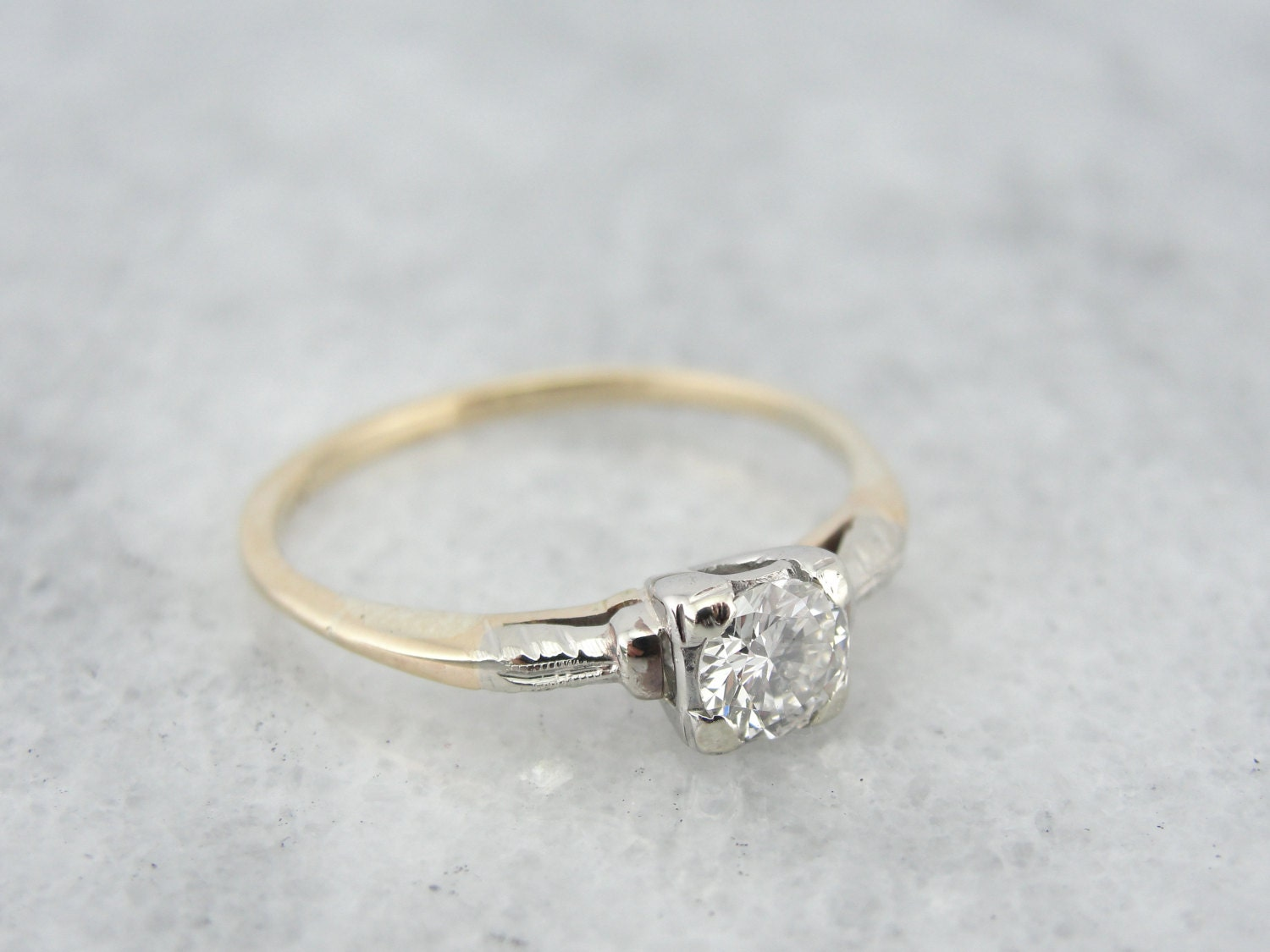 simple 1940 s retro engagement ring with engraved