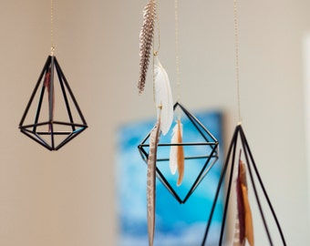 Black Geometric Himmeli mobile with feathers.