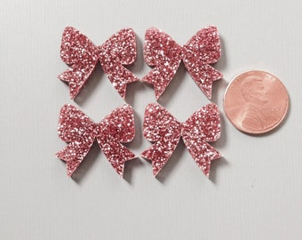 4x laser cut acrylic bow cabochons in Pink Glitter