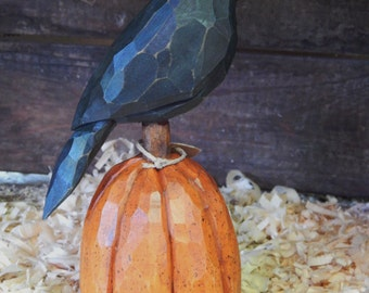 Hand Carved Crow on Carved Pumpkin.