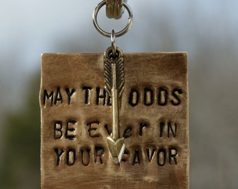 Hunger Games inspired Keychain. Stamped metal dyed with patina.