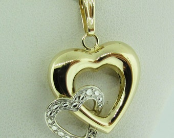 Double heart pendant. 14 K gold with necklace.