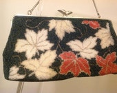 Charming and chic glass beaded maple leaf clutch purse with chain handle