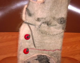 Alpaca wet felted wine cozy. White background with gray and red fiber highlights.  Red wood beads with gray leather closer.