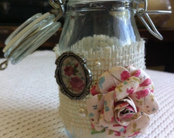 """Decorative glass jar: 4.5"""" x 2.25"""" jar with latched lid, embellished with burlap, pearl beads, paper rose and silver frame pendant"""