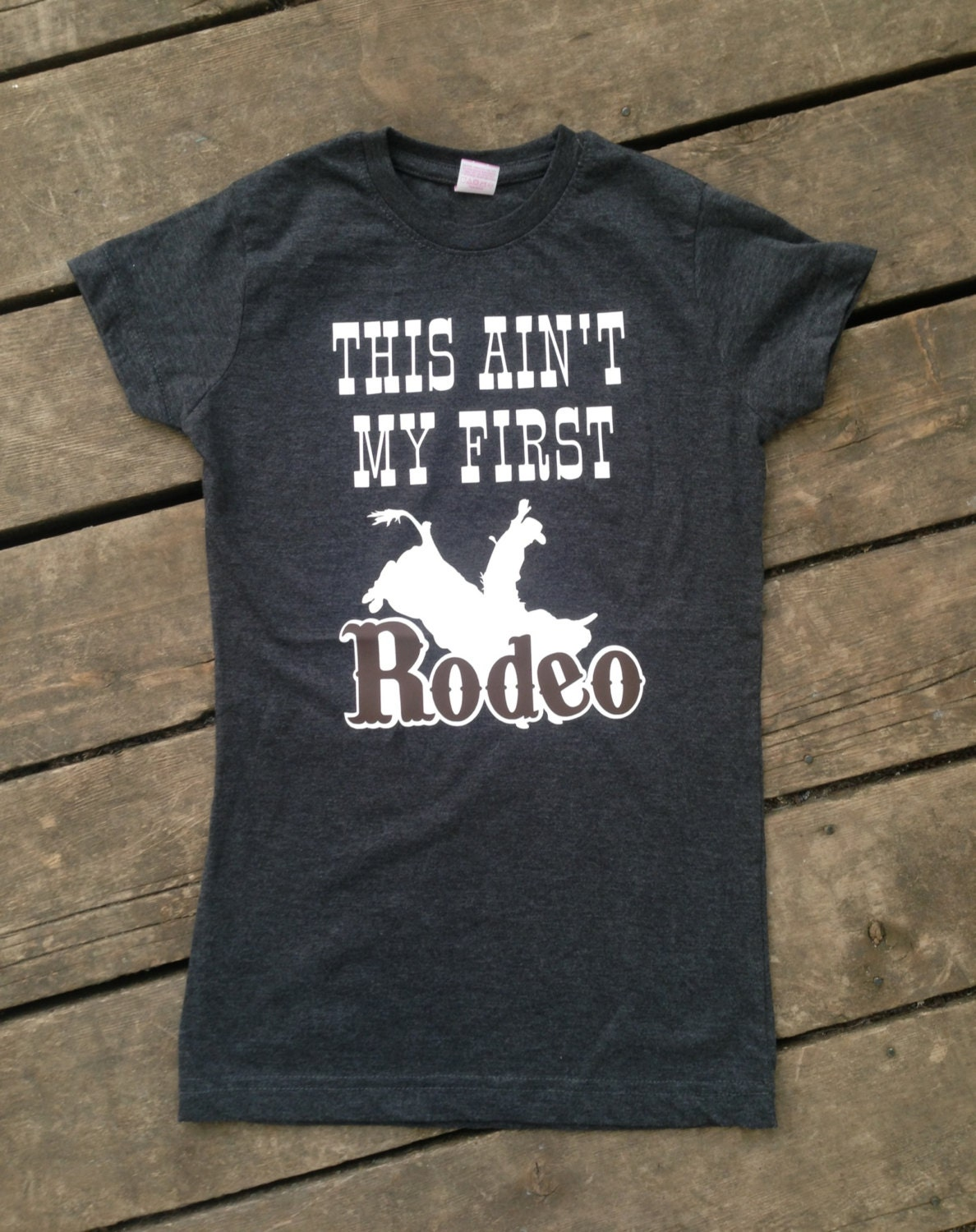 This ain 39 t my first rodeo t shirt country tank by for Ranch dress n rodeo shirts