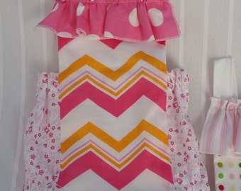 Bubble Romper Ruffle Sunsuit in orange and pink chevron, dots and flowers