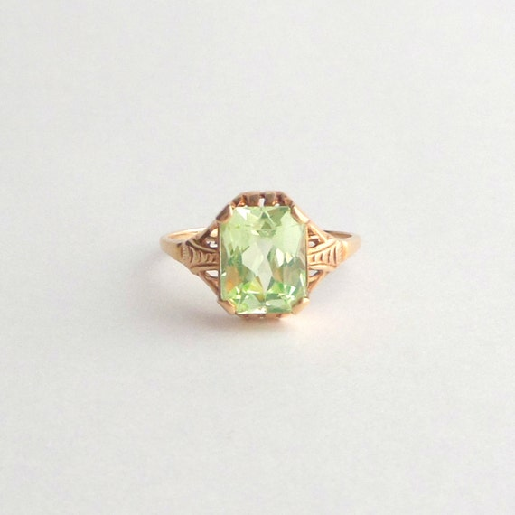 peridot gold ring large emerald cut late deco by pinguim
